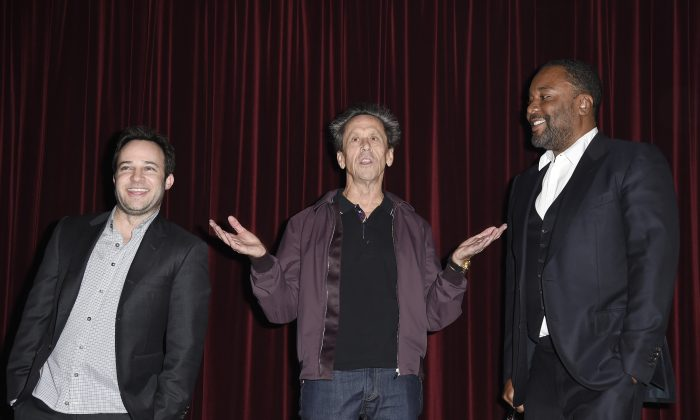 "(L-R) Executive producers Danny Strong, Brian Grazer, and Lee Daniels of the new television drama series ""Empire"" in West Hollywood, Calif.. on November 3, 2014. (Kevork Djansezian/Getty Images)"