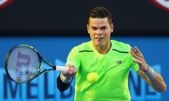 Milos Raonic plays a forehand against Novak Djokovic at the 2015 Australian Open in Melbourne on Jan. 28, 2015. (Scott Barbour/Getty Images)