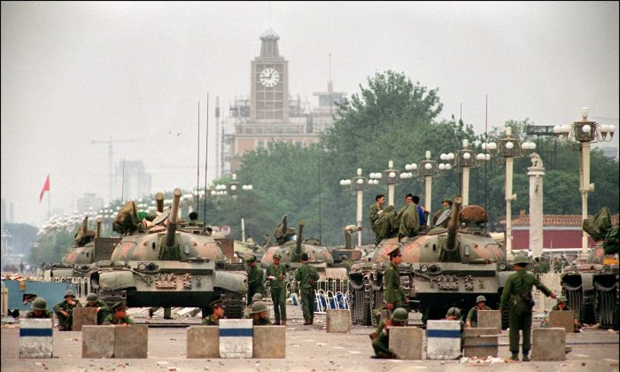 """People's Liberation Army tanks guard strategic Chang'an Avenue leading to Tiananmen Square on June 6, 1989. Canadian officials stationed in Beijing at the time described China's Communist Party leadership as a """"gerontocracy"""" that was """"bereft of any credible claim to legitimacy,"""" according to cables obtained by Blacklock's Reporter. (Manuel Ceneta/AFP/Getty Images)"""