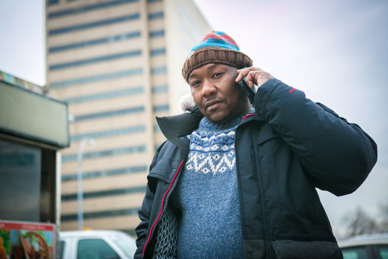 Derrick Hamilton on the phone, giving legal advice to wrongfully convicted prisoners. (Benjamin Chasteen/Epoch Times)