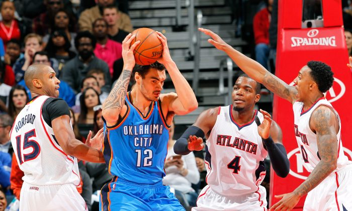 Steven Adams #12 of the Oklahoma City Thunder grabs a rebound against Al Horford #15, Paul Millsap, and Jeff Teague #0 of the Atlanta Hawks at Philips Arena on January 23, 2015 in Atlanta. (Photo by Kevin C. Cox/Getty Images)