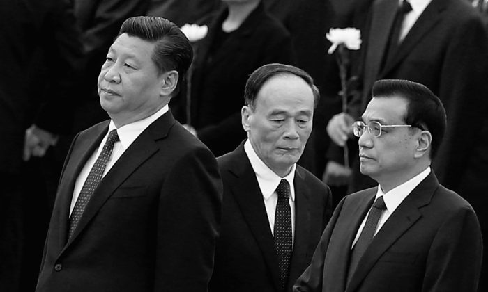 """Communist Party general secretary Xi Jinping (L), Premier Li Keqiang (R), and disciplinary  agency boss Wang Qishan (C), in Beijing, on Sept. 30, 2014. Growing numbers of Chinese officials have perished of """"unnatural causes,"""" including suicide, since Xi Jinping took power in late 2012. (Feng Li/Getty Images)"""