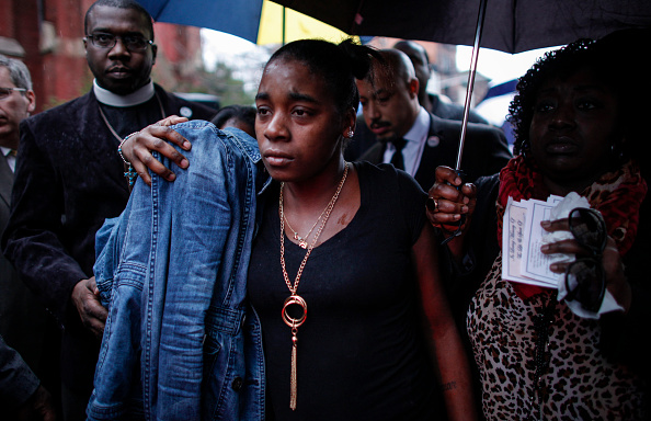 :  Family members of Akai Gurley attend his funeral service at the Brown Memorial Baptist Church on December 6, 2014 in the Brooklyn borough of New York City.  (Kena Betancur/Getty Images)