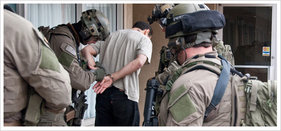 FBI SWAT team making an arrest. (Courtesy FBI)