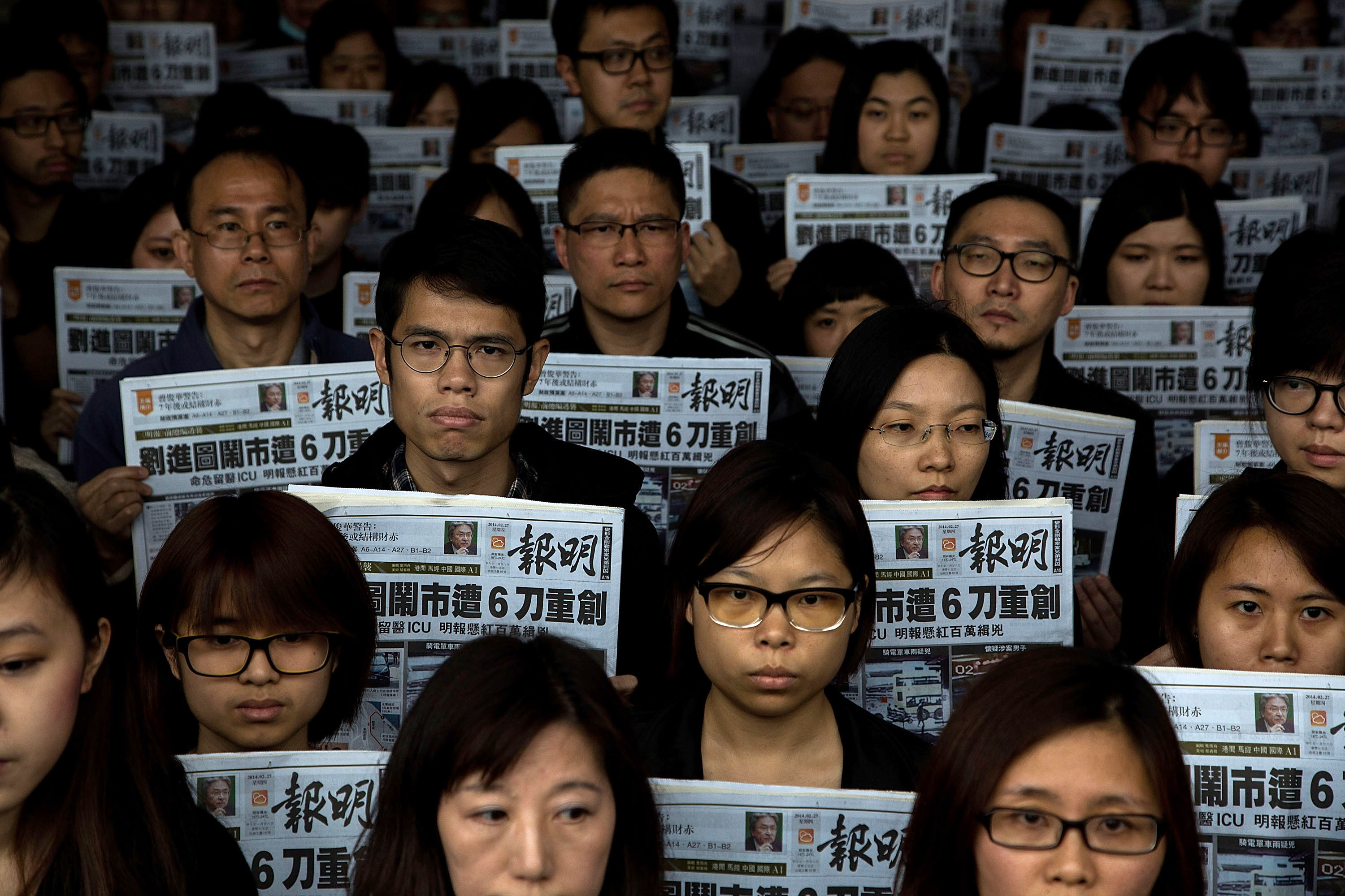 I Call the Shots, Under Fire Hong Kong Newspaper Editor Declares as Staff Protest Lead Story Change