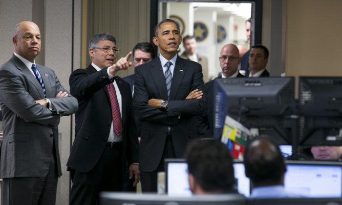 U.S. President Barack Obama is escorted by Jeh Johnson, Secretary Of Homeland Security, (L) and Richard M. Chavez, Director of Operations Coordination and Planning, (C) as he visits the National Operations Center (NOC) at the Department of Homeland Security in Washington, D.C., after speaking about the administration's fiscal year 2016 budget request released earlier in the day on Feb. 2, 2015. (Kristoffer Tripplaar-Pool/Getty Images)