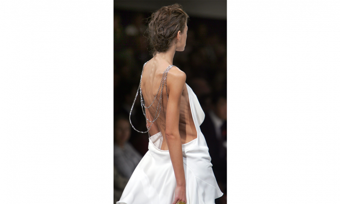 An ultra-thin model presents an ensemble by French fashion house Guy Laroche in Paris on Oct. 7, 2006. Eating disorders may be far more prevalent than previously thought, according to a poll commissioned by the National Eating Disorder Information Centre. (AP Photo/Remy de la Mauviniere)