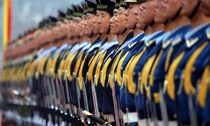 A Chinese honor guard at the Defense Ministry in March 22, 2007 Beijing. A Pentagon China analyst says that the PRC is in a long competition to surpass and supplant the United States. (Elizabeth Dalziel/Getty Images)