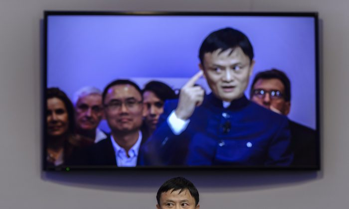 Alibaba's Chairman Jack Ma, in Davos, Switzerland, on Jan. 23. Alibaba lost US$11 billion overnight on Jan. 28 after getting into a spat with a Chinese regulator, as the company's once helpful political ties begin to trip it up. (Fabrice Coffrini/AFP/Getty Images)