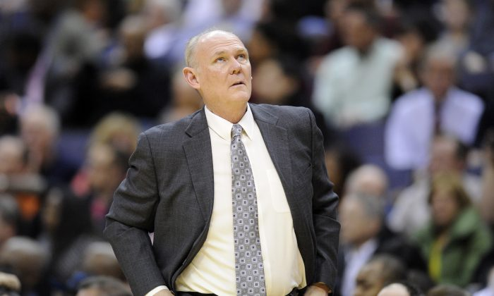 Denver Nuggets head coach George Karl looks on during the first half of an NBA basketball game against the Washington Wizards, Friday, Feb. 22, 2013, in Washington. (AP Photo/Nick Wass)