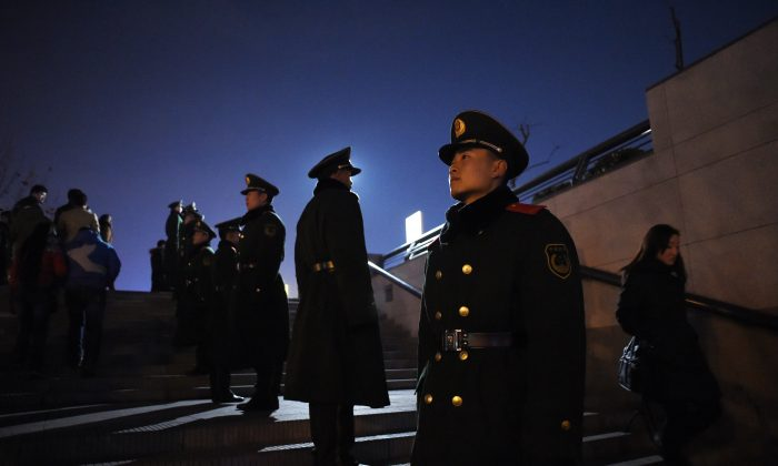 A group of police officers stand guard in Shanghai on January 3, 2015. On Jan. 28, police in southwestern China's Guizhou Province secretly dissected a victim's body without notifying his family, and the outraged victim's family have accused police of stealing his organs. (Wang Zhao/AFP/Getty Images)