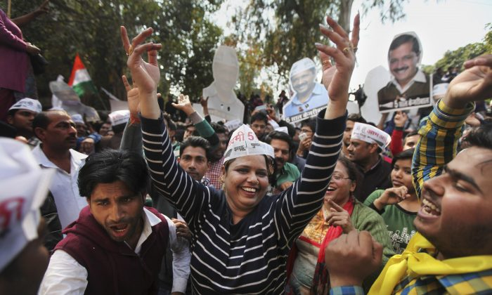 Supporters of the Aam Aadmi Party, or Common Man's Party, dance as they celebrate their party's victory in New Delhi, India, on Feb. 10, 2015. (AP Photo/Altaf Qadri)
