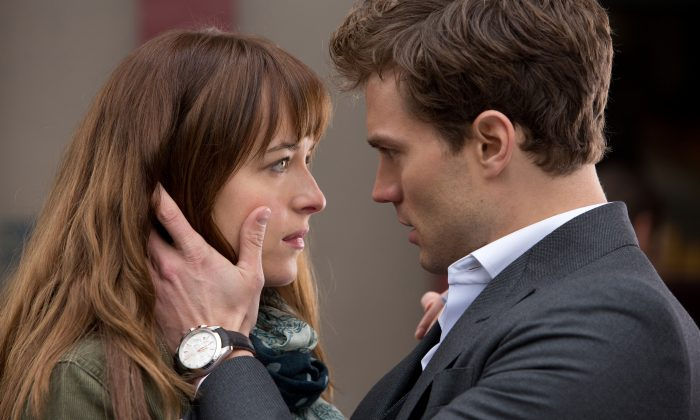"Billionaire entrepreneur Christian Grey (Jamie Dornan) and curious college student Anastasia Steele (Dakota Johnson) in ""Fifty Shades of Grey."" ( Chuck Zlotnick/Universal Studios/Focus Features)"