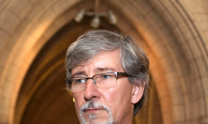 Privacy Commissioner Daniel Therrien prepares to appear at the Commons Human Rights committee on Parliament Hill June 10, 2014. Therrien has raised concerns about the government's anti-terrorism bill but has yet to pass final judgement. (The Canadian Press/Fred Chartrand)