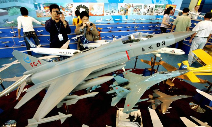 A model of the FC-1, one of the Chinese regime's fighter jets, is shown on display at China's Zhuhai Airshow on Oct. 31, 2004. The Chinese regime may start developing FC-1 jets alongside Argentina. (Mike Clarke/AFP/Getty Images)