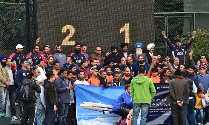 Singh Sabha Sports Club (SSSC-A) and supporters celebrate winning their first HKHA Premiership title after winning their match against Khalsa–A 2-1 at King's Park on Sunday Feb 8, 2015. (Bill Cox/Epoch Times)
