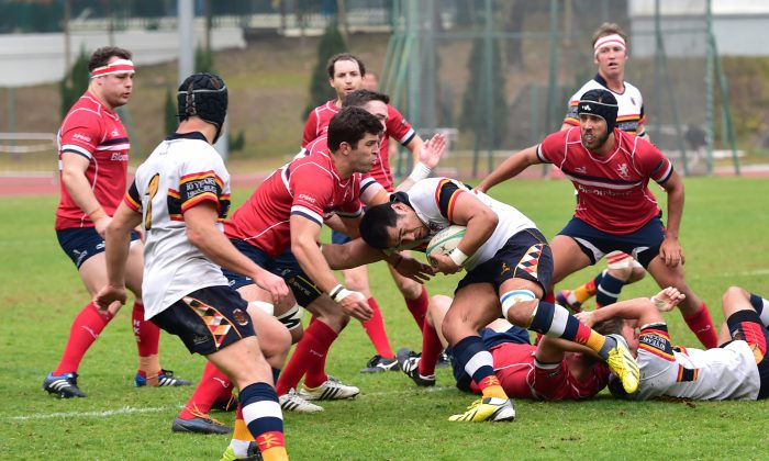 Frank Nelisi tries to make progress for HKCC HKRFU Premiership Champions but finds his way blocked by Kane Boucaut of HK Scottish in the first half of their match at Aberdeen SG on Saturday Feb 7, 2015. HKCC went on to win the match 19-9. (Bill Cox/Epoch Times)