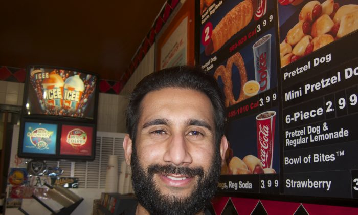 Osman Khan, of Hayward, commutes over forty miles to his cashier job at Pretzelmaker because jobs are hard to come by in his city.  (Chun Lee/Epoch Times)
