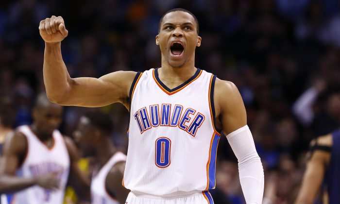 Oklahoma City Thunder guard Russell Westbrook (0) reacts after making a basket against the New Orleans Pelicans during the second half of a NBA basketball game in Oklahoma City, Friday, Feb. 6, 2015. (AP Photo/Alonzo Adams)