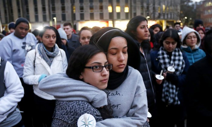 N.C. State University sophomore Firdaws Chahrour, right, and Danyah Dahbour before a vigil on their school campus to remember Deah Shaddy Barakat, 23, his wife Yusor Mohammad Abu-Salha, 21, and Abu-Salha's sister, Razan Mohammad Abu-Salha, 19, on Thursday, Feb. 12, 2015.  The three were killed Tuesday evening in Chapel Hill. (Ethan Hyman/ The News & Observer/AP)