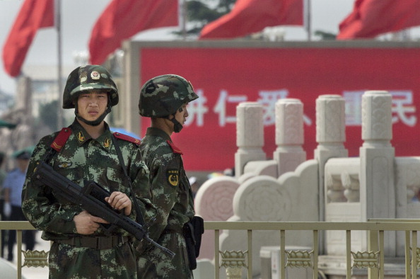 Chinese Paramilitary police stand guard in Tiananmen Square on June 4, 2014 in Beijing, China. Sydney think tank the Lowy Institute indicates there is underlying concern about China's growing influence in the region. (Kevin Frayer/Getty Images)