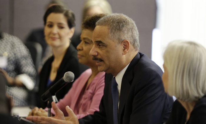U.S. Attorney General Eric Holder speaks during a police-community relations roundtable with elected officials and community leaders Thursday, Feb. 5, 2015, in Oakland, Calif. The Department of Justice is intervening in a class-action lawsuit against Clanton, Ala. for unconstitutional bail-setting practices. (AP Photo/Eric Risberg)
