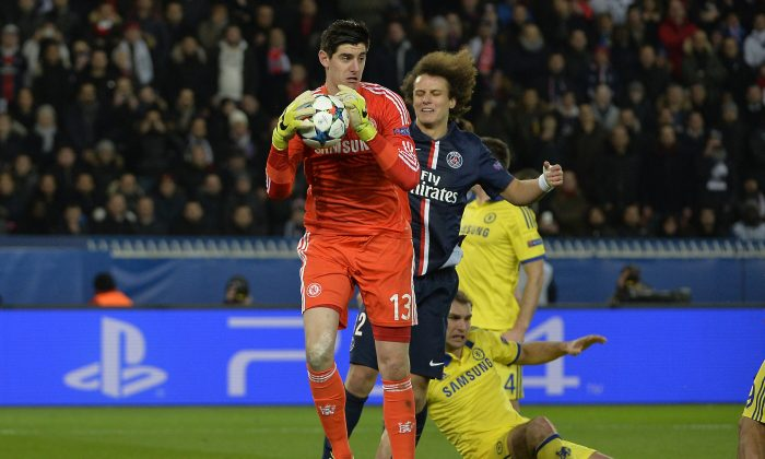 Chelsea's Thibaut Courtois catches the ball in UEFA Champions League Round of 16 action against Paris Saint-Germain at the Parc des Princes Stadium in Paris on Feb. 17, 2015. (Miguel Medina/AFP/Getty Images)