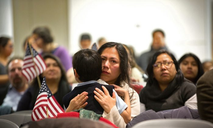 Martha Moran, holds her 6-year-old son Tonatiuh Moran, during a viewing party for President Barack Obama's speech on immigration policy reform in New York City on Nov. 20, 2014. (Kevin Hagen/Getty Images)