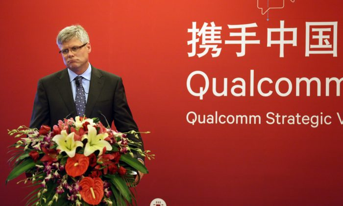 Qualcomm CEO Steve Mollenkopf attends a press conference in Beijing, China on July 24, 2014. (ChinaFotoPress via Getty Images)