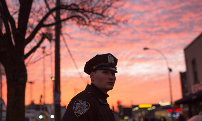 An officer directs traffic for the funeral of slain NYPD Officer Rafael Ramos, one of two officers murdered while sitting in their patrol car in an ambush in Brooklyn, New York City, in December 2014. (Kevin Hagen/Getty Images)