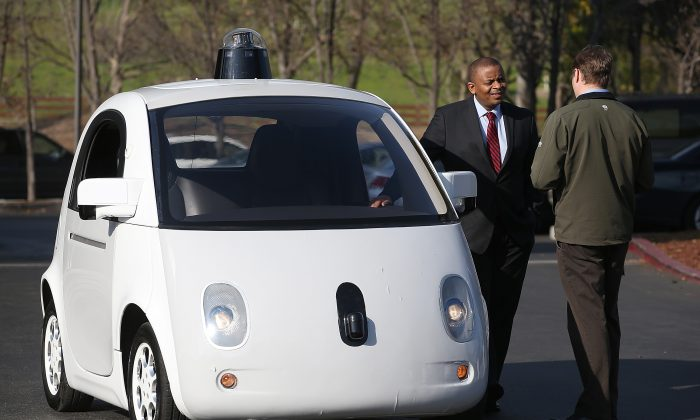 U.S. Transportation Secretary Anthony Foxx (L) inspects a Google self-driving car at the Google headquarters on Feb. 2, 2015, in Mountain View, Calif. Semi-autonomous cars are already on the market, with their capabilities continually expanding. (Justin Sullivan/Getty Images)