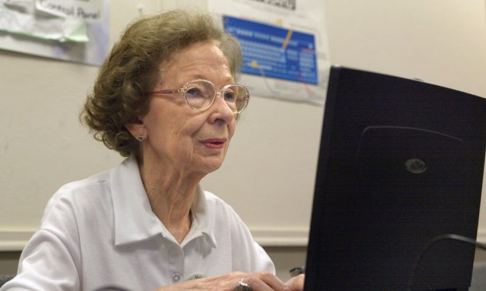 Suzette D'Hooghe, 77, works on her laptop during a computer class in Des Plaines, Illinois, July 23, 2003. A project led by a group of Ontario high school students is opening up a new world for seniors by teaching them basic computer skills. It is helping close not only the digital divide, but also the generational one. (Tim Boyle/Getty Images)