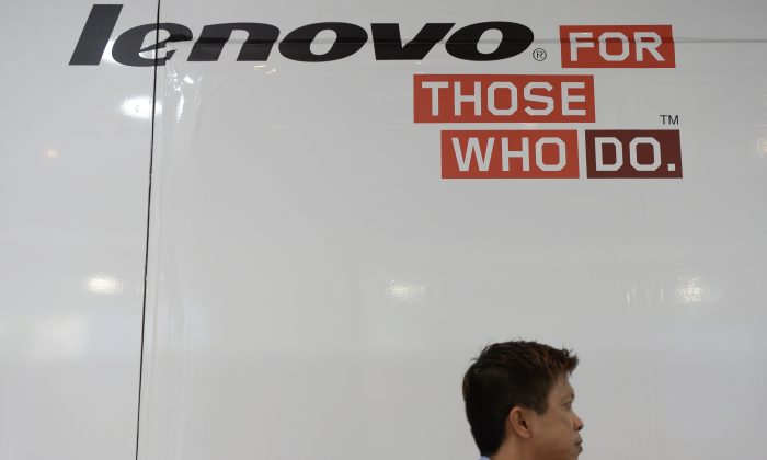 A man walks past Lenovo advertising at a computer centre in Hong Kong on August 14, 2014. (Dale de la Rey/AFP/Getty Images)