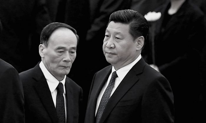 Chinese President Xi Jinping (R) and Secretary of the Central Commission for Discipline Inspection (CCDI) Wang Qishan (L) on Sept. 30, 2014 in Beijing. CCDI has named 26 central-government-owned state-run companies as targets for the next round of investigations. (Feng Li/Getty Images)