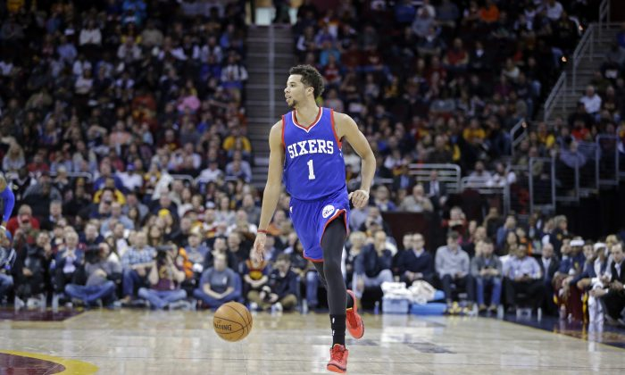 Philadelphia 76ers' Michael Carter-Williams (1) brings the ball into the forecourt in an NBA basketball game against the Cleveland Cavaliers Monday, Feb. 2, 2015, in Cleveland. (AP Photo/Mark Duncan)