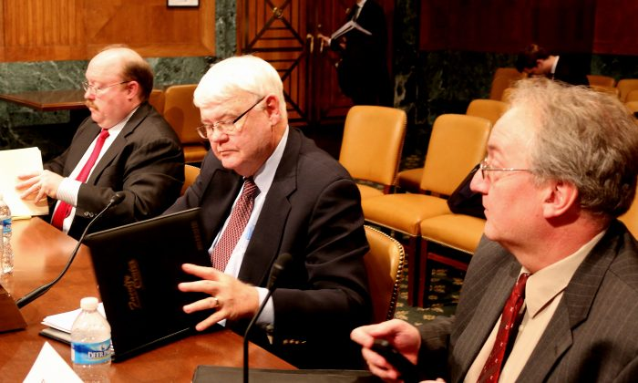 Three China experts testify before the U.S.-China Economic and Security Review Commission on Feb. 18. (L to R) Richard D. Fisher, Jr., senior fellow, Asian Military Affairs, International Assessment and Strategy Center, Alexandria, Va.; Dr. Roger Handberg, Department of Political Science, University of Central Florida, Orlando, Fla.; and Dr. Phillip Saunders, distinguished research fellow, National Defense University, Washington, D.C. (Gary Feuerberg/ Epoch Times)