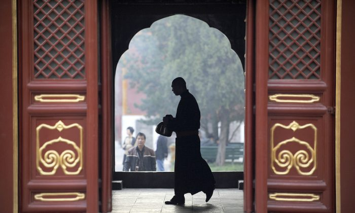 A monk at the Yonghegong Lama temple in Beijing in Beijing on October 24, 2012. Many Chinese officials, seeking advice for their careers, have built friendships with monks and qigong masters in recent years. (Wang Zhao/AFP/Getty Images)