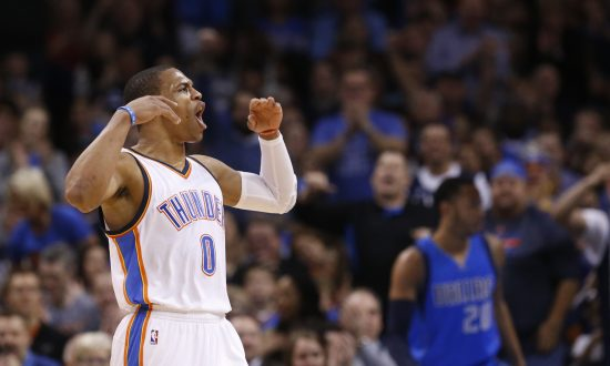 4cd5f3a37 Oklahoma City Thunder guard Russell Westbrook (0) gestures to the crowd  following a dunk
