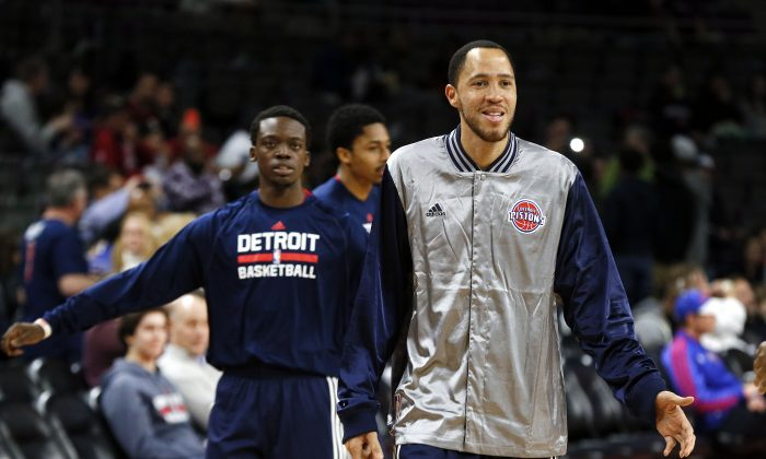 Detroit Pistons' Reggie Jackson, left, and Tayshaun Prince warm up before an NBA basketball game against the Washington Wizards in Auburn Hills, Mich., Sunday, Feb. 22, 2015. (AP Photo/Paul Sancya)