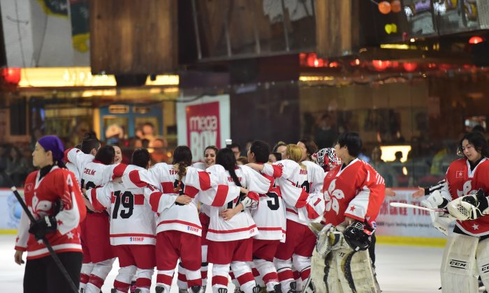 Turkey celebrates their important win against Hong Kong to move them into the lead with 6-points on day-2 of the 2015 IIHF Ice Hockey Women's World Championship Division II Group B Qualifier tournament at Mega Ice, on Thursday Feb 19, 2015. (Bill Cox/Epoch Times)