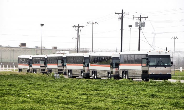 Busses are lined up in front of Willacy County Correctional Center inTexas Feb. 22, 2015. Security personnel have regained control of the South Texas prison where inmates had set fires and caused significant damage after taking over part of the facility.. (AP Photo/Valley Morning Star, David Pike)
