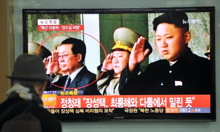 A South Korean man watches TV news about the alleged dismissal of Jang Song-Thaek, North Korean leader Kim Jong-Un's uncle, at a railway station in Seoul on December 3, 2013. (Jung Yeon-Je/AFP/Getty Images)