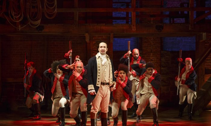 """In this image released by The Public Theater, Lin-Manuel Miranda, center, performs in the musical """"Hamilton"""" at The Public Theater in New York. (AP Photo/The Public Theater, Joan Marcus)"""