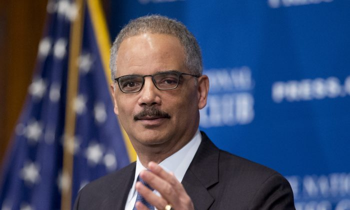 """Attorney General Eric Holder speaks about the 2013 initiative called """"Smart on Crime,"""" which directed prosecutors to limit their use of mandatory minimum punishments, Tuesday, Feb. 17, 2015, at the National Press Club in Washington, D.C.  (AP Photo/Manuel Balce Ceneta)"""