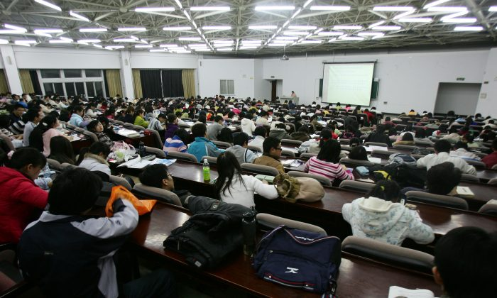 Students attend a lesson at the Northeast Normal University on March 22, 2007, in Changchun of Jilin Province, China. Nine Chinese lawyers submitted an application to the Ministry of Education on Feb. 9 requesting the legal basis for its banning western values in Chinese universities. (China Photos/Getty Images)