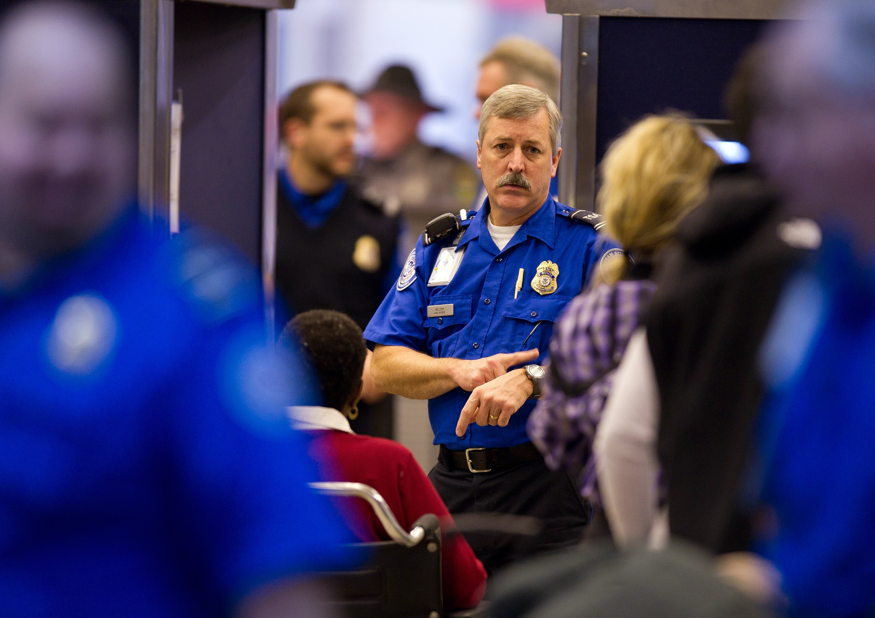 A TSA agent instructs travelers through the security lines at the Pittsburgh International Airport on Nov. 24, 2010. (Jeff Swensen/Getty Images)