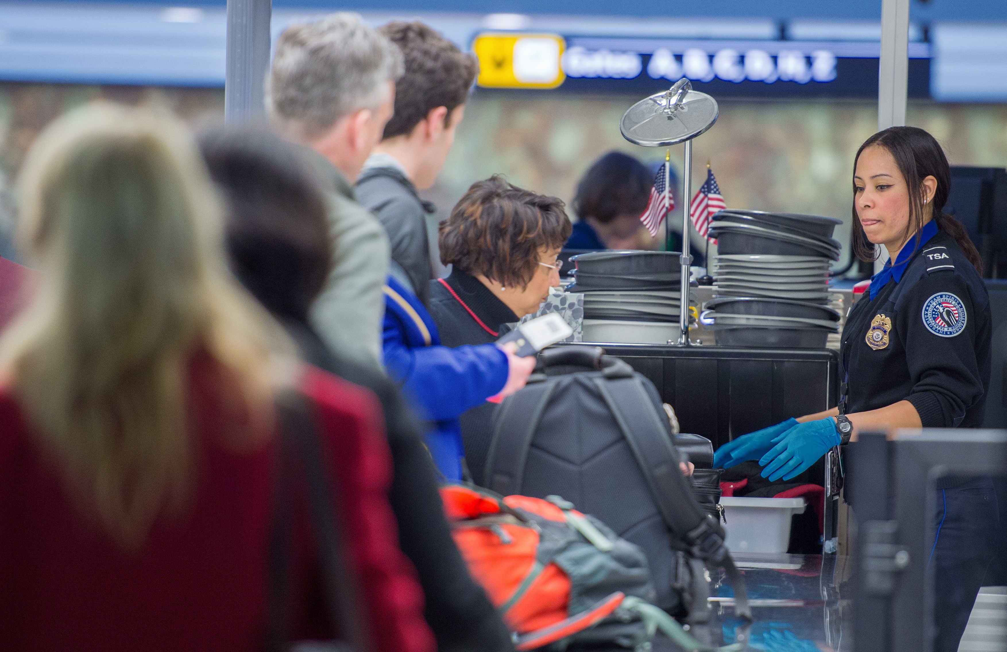 Airline travelers are processed at a Transportation Safety Agency security checkpoint at the Dulles International Airport (IAD) in Sterling, Va., on Dec. 23, 2014 (PAUL J. RICHARDS/AFP/Getty Images)