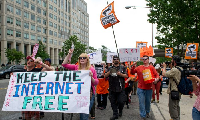 Protesters hold a rally to support 'net neutrality' and urge the Federal Communications Commission (FCC) to reject a proposal that would allow Internet service providers to create internet fast lanes, on May 15, 2014 at the FCC in Washington, DC. (KAREN BLEIER/AFP/Getty Images)