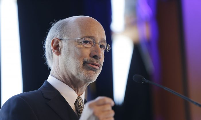 Gov. Tom Wolf at MusikFest Café in Bethlehem, Pa., on Wednesday, Feb. 25, 2015. NY Towns considering seceding to Pennsylania for the fracking benefits may think twice if Wolf's proposed gas taxes get approved.  (AP Photo/Matt Rourke)