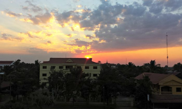 The sun set over Banlung city in Eastern Cambodia, on Feb. 5, 2015. Two decades after a devastating civil war, Cambodia's recovery is taking off. (Valentin Schmid/Epoch Times)